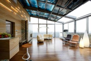 OpenAir-sliding roof 4-part in conservatory in Moscow (object 1. residential conservatory with 4-part OpenAir-sliding roof and electrochromic glasses for the control of view and sun protection on the roof terrace of a Moscow high-rise)