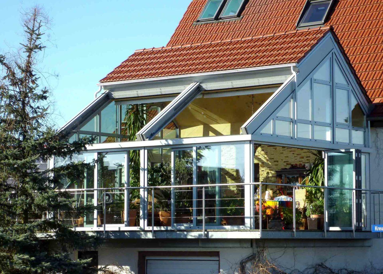 OpenAir Schiebedach in Wahrenberg an der Ems (Objekt  1098). Wohnraumwintergarten mit Kombination aus Ziegeldach und OpenAir-Schiebedach