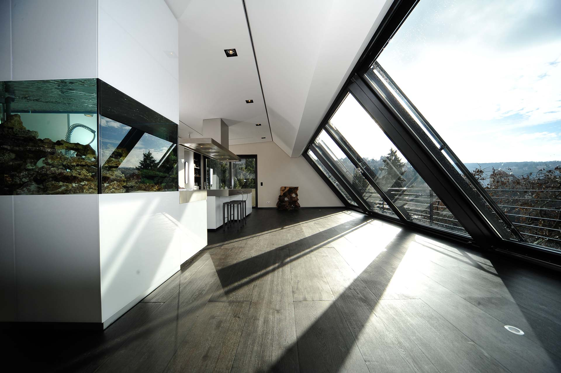 Panorama_roof_slidingwindow in Stuttgart (object 1071). Modern roof extension with great view over Stuttgart through 4-part Panorama-AL roof sliding window (900 cm x 350 cm)