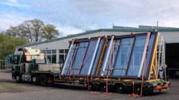 Semitrailer truck for the transport of 2 OpenAir sliding roof windows.